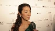 INTERVIEW Michelle Yeoh and Carolina Parsons on amfAR at 2015 amfAR Hong Kong gala at Shaw Studios on March 14 2015 in Hong Kong