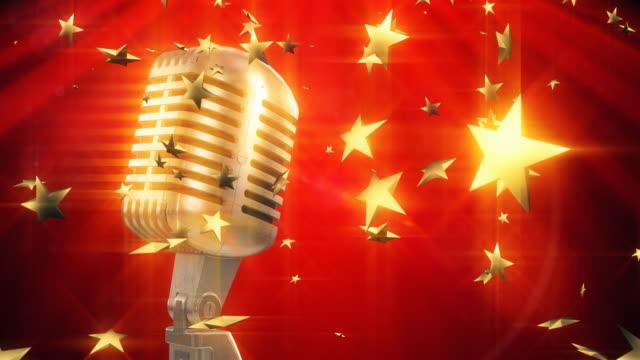 4 K Mikrofon mit goldenen Sternen auf der Bühne/Endlos wiederholbar