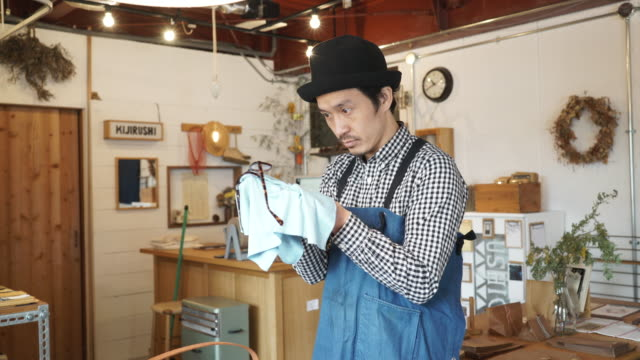 Mid adult man working in a small general shop