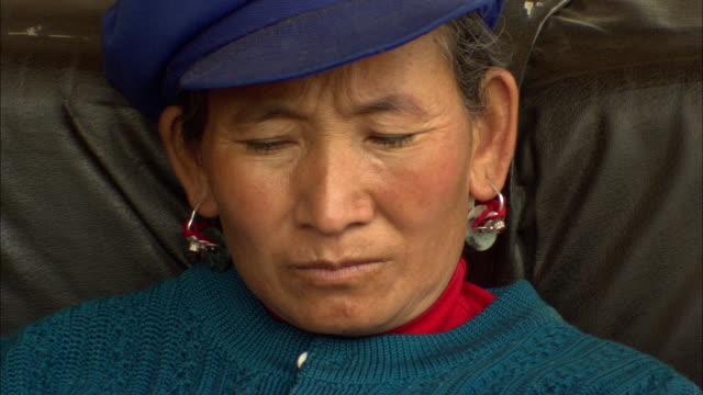 CU Mid adult woman looking around, Lijiang, Yunnan, China