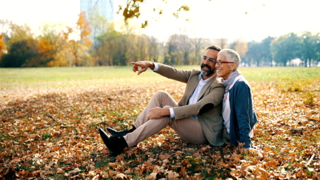Mid aged couple in a park