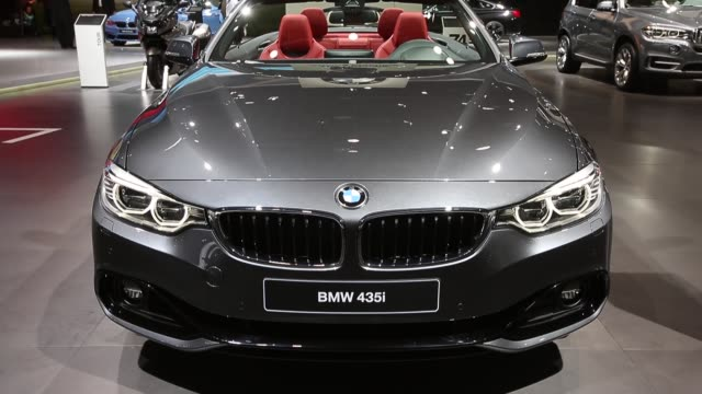 Mid Shot a BMW 435i convertible is on display at the North American International Auto Show on January 14 2014 in Detroit Michigan The auto show...