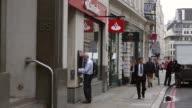 Mid Shot A man uses a cashpoint at Santader Bank Gracechurch Street branch