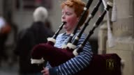 Mid Shot A Young Boy Playing Bagpipes Street entertainers perform on Edinburgh's Royal Mile during the city's Festival Fringe on August 21 2013 in...