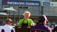 Mid Shot an AFL Record seller sells match day programs outside Patersons Stadium