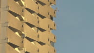 mid shot balconies in sunset