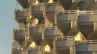 mid shot balconies with satellite dishes