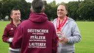 Mid Shot fans of Kaiserslautern talk together prior to the Second Bundesliga match between 1 FC Koeln and 1 FC Kaiserslautern at RheinEnergieStadion...