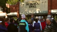 Mid Shot football fans queue to enter Patersons Stadium for the 2013 AFL Preliminary final between the Fremantle Dockers and the Sydney Swans