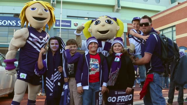 Mid Shot Fremantle Docker fans show their support brfore the 2013 AFL Preliminary final between the Fremantle Dockers and the Sydney Swans