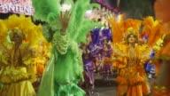 Mid Shot general view of Mangueira Samba School parade during the 2014 Brazilian Carnival at Sapucai Sambadrome on March 02 2014 in Rio de Janeiro...