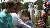 Mid shot Kristen Smith of Frederick Maryland visits her brother USMC Sergeant David James Smiths gravesite with her son Logan and daughter Vienna at...