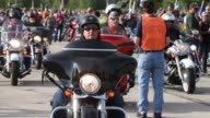 Mid Shot Motorcycle enthusiasts gather in a parking lot at Miller Park before riding in a parade through downtown to celebrate HarleyDavidson's 110th...