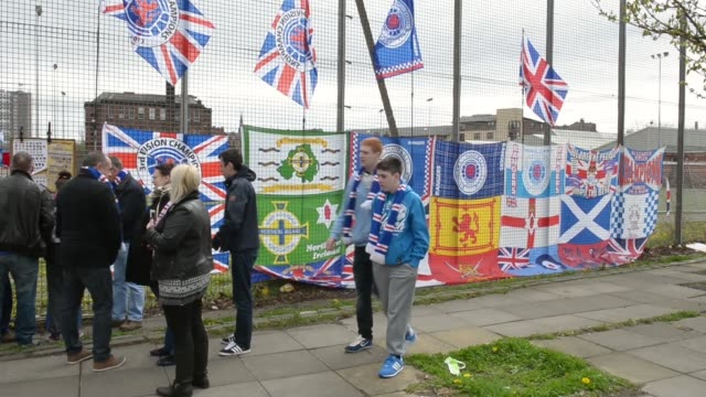 Mid shot of a fence covered with clubs flags Rangers v Berwick Rangers IRNBRU Scottish Third Division at Ibrox Stadium on May 04 2013 in Glasgow...