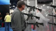 Mid shot of assault rifle stand on the show floor during the 2013 NRA Annual Meeting and Exhibits at the George R Brown Convention Center on May 4...