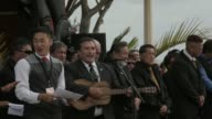 Mid shot of government officials singing and playing ukulele New Zealand Taniwha and Dragon Festival on April 27 2013 in Auckland New Zealand Mid...