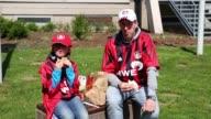 Mid shot of Leverkusen fan with daughter eating in front of stadium Bayer 04 Leverkusen v TSG 1899 Hoffenheim Bundesliga Editorial Video Footage at...
