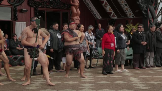 Mid shot of Maori warriors performing New Zealand Taniwha and Dragon Festival on April 27 2013 in Auckland New Zealand Mid shot of Maori warriors...