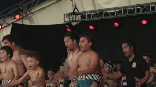 Mid shot of Maori warriors performing traditional war dance on stage New Zealand Taniwha and Dragon Festival on April 27 2013 in Auckland New Zealand...