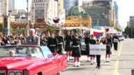 Mid shot of marching parade with classic car in front Australians Commemorate ANZAC Day on April 25 2013 in Various Cities Australia Mid shot of...