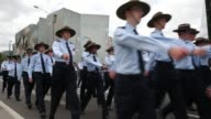 Mid shot of members of the Australian Air Force Cadets holding Australian flags as they march during the annual Anzac Day march Australians...