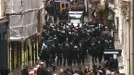 Mid shot of riot police at Beak Street Police are seen on Beak Street where anti G8 protesters had occupied a building on June 11 2013 in London...