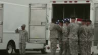 Mid shot of soldiers putting a coffin into the back of a van Bodies Of Seven Servicemen Killed In Afghanistan Return To US on May 07 2013 in Dover...