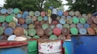 Mid shot of workers unstacking barrels