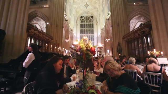 Mid Shot people sitting at banquet table Catering students from the City of Bath College serve more than a 100 diners sat between the choir stalls a...