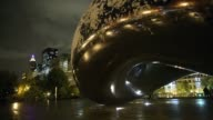 Mid Shot snow collects on Anish Kapoor's Cloud Gate in Millennium Park on November 11 2013 in Chicago Illinois The snowfall was the first of the...