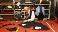 Mid Shot tailors at GD Golding who hold a Royal Warrant for services to the Royal Household produce bespoke garments in their workshop on September...