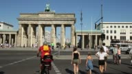 Mid Shot The Brandenburg Gate and People crossing the road Political advertisements are posted all over Berlin as the campaign for the 2013 German...