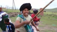 Mid Shot Xhosa women sing and dance as young men take part in a manhood ceremony in Qunu ahead of the funeral of Nelson Mandela on December 13 2013...