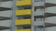 mid shot yellow balconies