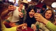 Mid to close tracking shot of a group of friends drinking at bar Mid to close tracking shot of a group of friends on April 05 2013 in Cortina...