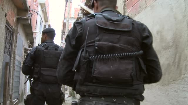 Mid Tracking Shot walking through alley ways with special forces