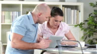 HD DOLLY: Mid-Adult Couple Examining Home Finances