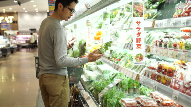 Mid-adult man shopping fresh vegetable