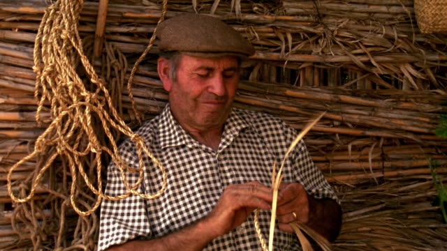 MS middle age man twisting cords into rope / Custonaci, Sicily