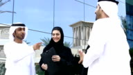 Middle eastern business people talking on the street - Slowmotion