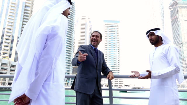 Middle eastern businessmen meeting western man outdoor