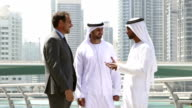 Middle eastern businessmen meeting western man - Stock video