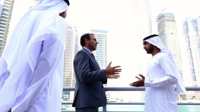 Middle eastern businessmen meeting western man