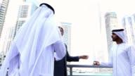 Middle eastern businessmen meeting western man-handshake