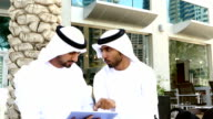 Middle eastern mans with digital tablet outdoor - Slowmotion