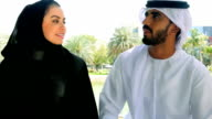 Middle Eastern young couple are talking in a park