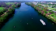 Middle of Lake Aerial View Austin Texas Colorado River Fun Spring water activities with kayakers and Party Boat during SXSW Spring Break 2016