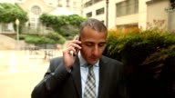 Middle-Eastern Business Man on Phone in Urban Setting