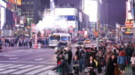 Midnight steam, traffic and tourists in Times Square, New York City
