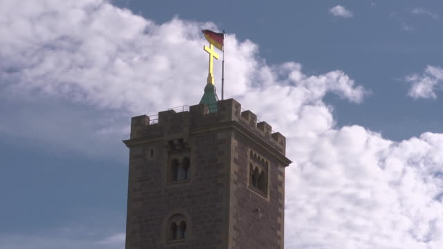 Midshot of tower of Wartburg Castle with Flag of Germany